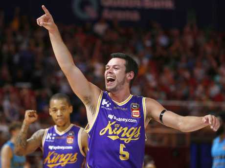 Jason Cadee celebrates after draining a three.