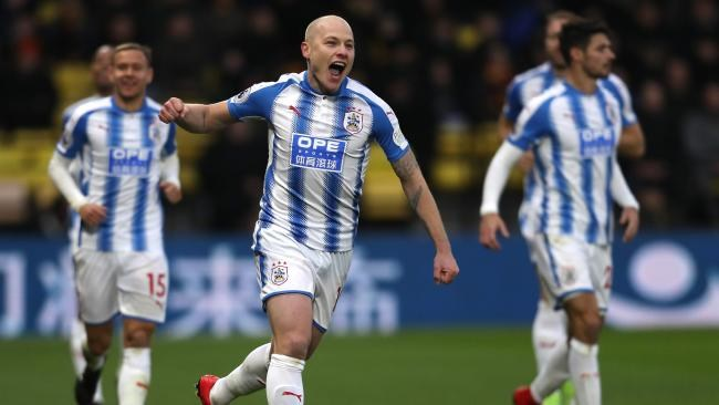 Aaron Mooy of Huddersfield Town celebrates.