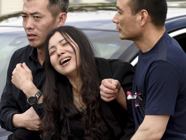 Peter Wang's mother Hui cries as she is helped into a car after the memorial service for her 15-year-old son at Kraeer Funeral Home in Coral Springs, Florida. Picture: Taimy Alvarez/South Florida Sun-Sentinel via AP