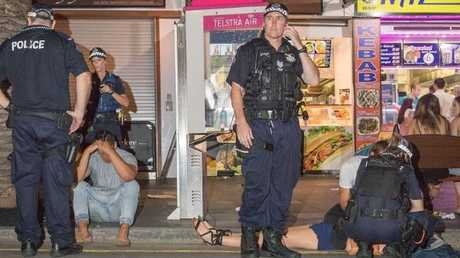 The scene in the Surfers Paradise party precinct at 2am Sunday - nightclub bosses are planning to call for tougher sentences to party precinct thuggery.