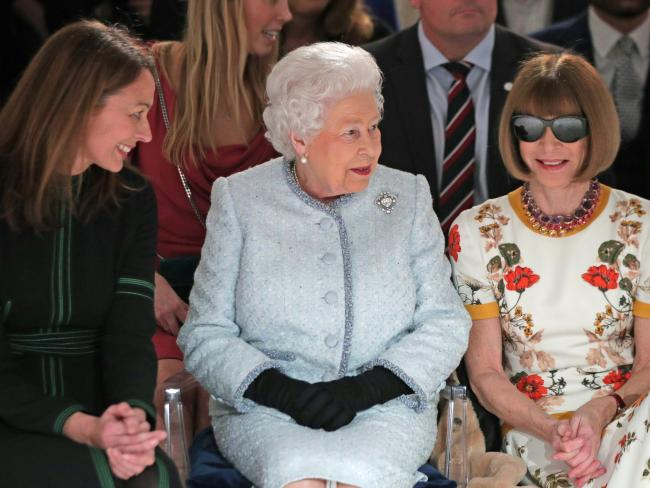 Queen Elizabeth II sits next to Anna Wintour and Caroline Rush at Richard Quinn's runway show. Picture: Yui Mok — Pool/Getty Images