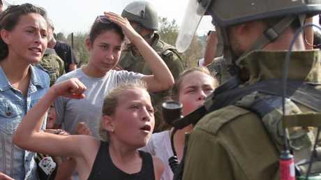 This photo from 2012 shows Ahed Tamimi gesturing in front of an Israeli soldier during a protest.