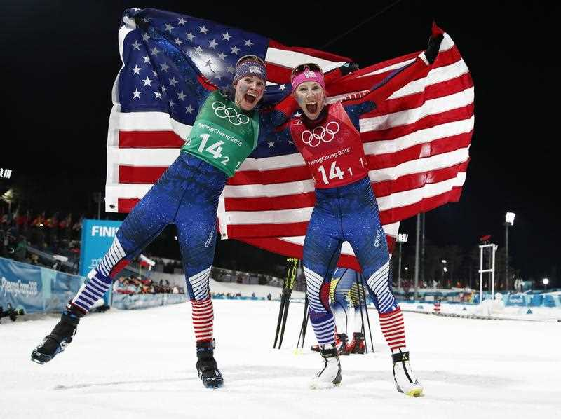 USA's Jessica Diggins and Kikkan Randall celebrate winning gold in the women's cross country team sprint free final.