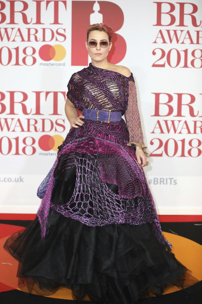 Actress Noomi Rapace poses for photographers upon arrival at the Brit Awards 2018 in London, Wednesday, Feb. 21, 2018.