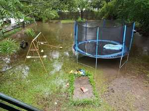 PHOTOS: Backyards turn to swamps in overnight downpour