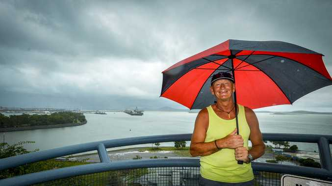 The skies over Gladstone darkened on Thursday as wet weather threatened to settle in. PICTURED: Rick Mitchell who is travelling from the UK didn't mind the wet conditions at Gladstone's Auckland Point Lookout.