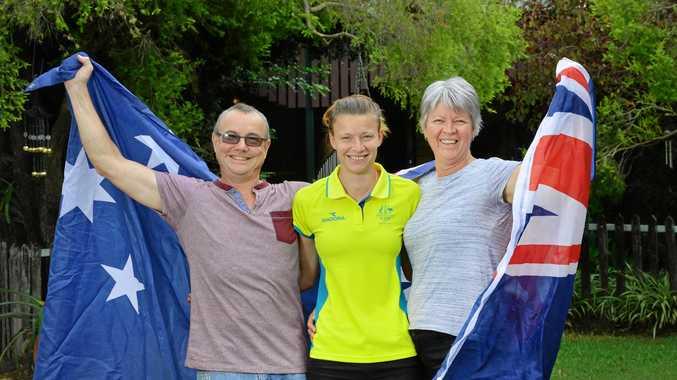 AUSSIE PRIDE: Commonwealth Games high jump representative Cassie Purdon with parents John and Ruth Purdon at their Lanefield home.