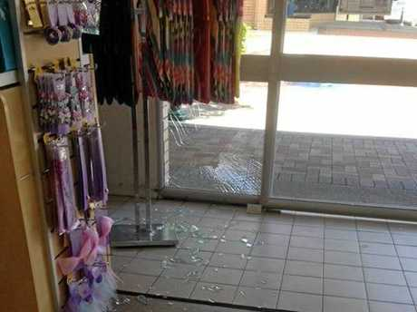 The offender smashed the glass window at Best & Less before walking quickly away.