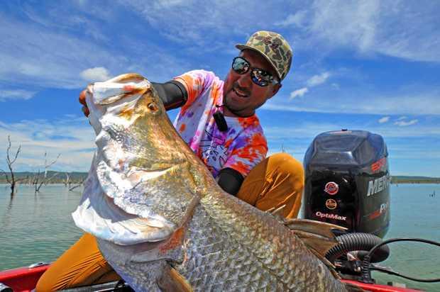 BIG BARRA: Japanese fishing guru Takuma Hata reeling in the big barra at Lake Proserpine.