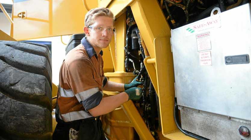 HARD WORKER: Hastings Deering apprentice Riley Stewart toils over machinery in Rockhampton.