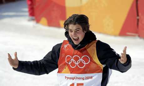 Nico Porteous celebrates after claiming bronze in the men's halfpipe.
