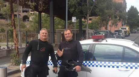 Tony Strazzari (left) and his mate Paul Szerenga discovered an unexploded bomb in Sydney Harbour.