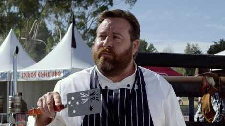 Shane Jacobson, as Dazza, with his Australian flag spatula in a scene from Australian film The BBQ