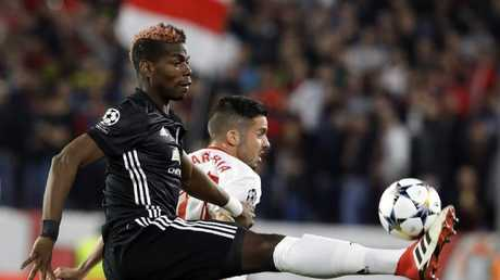 Manchester United's Paul Pogba fights for the ball with Sevilla's Pablo Sarabia