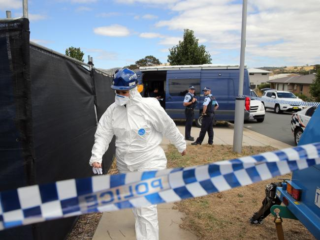 ACT Police forensic officer at the scene of the tragedy which claimed three lives. Picture Gary Ramage.