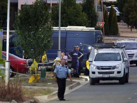 Police block off the suburban street after three people were found dead after a suspicious house fire in Canberra. Picture Gary Ramage.