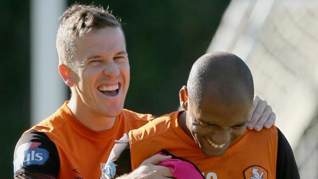 Brisbane Roar skipper Matt MacKay jokes with cult hero Henrique at training. Picture: Jono Searle.