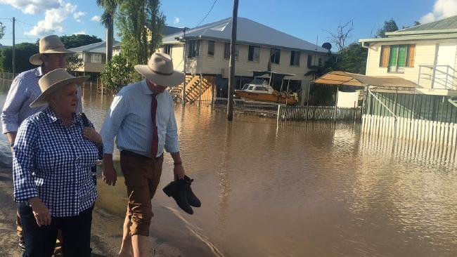 Joyce removes his boots to walk the streets of flood-ravaged Source: Twitter