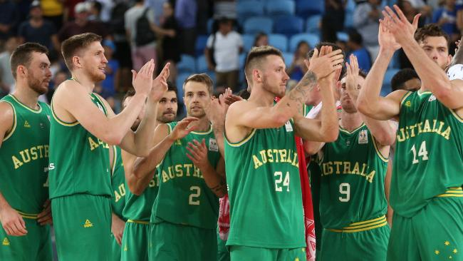 Boomers players celebrate their win over the Philippines on Thursday night.
