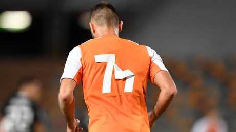 The numbers of Brisbane Roar defender Ivan Franjic's shirt are seen peeling off in the Asian Champions League playoff match against Ceres-Negros.