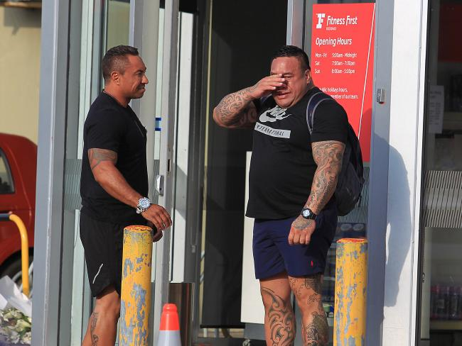 A man fights back tears out the front of Fitness First, Rockdale the scene were Mick Hawi was shot and later died. Picture: Supplied