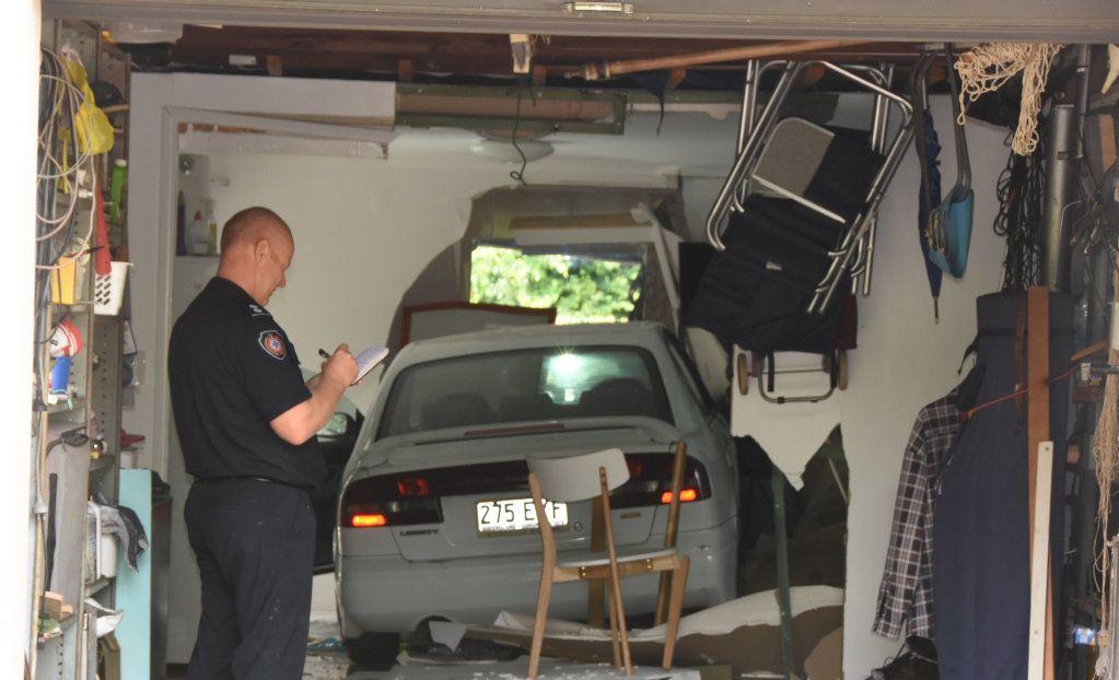 Photos taken at the scene where a car has crashed into a Noosa home