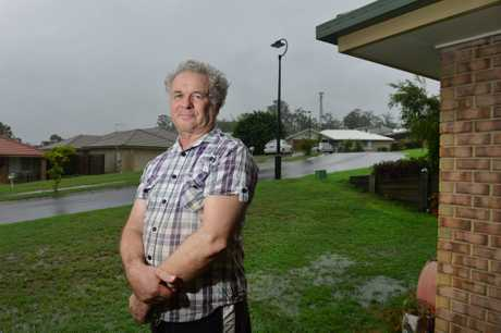HOUSES OR DUMP: Bundamba resident David Harris isnt passionately opposed to the proposed dump saying rubbish has to go somewhere but he says, landfill shouldnt be established so close to a growing residential housing estate.