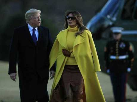 President Donald Trump walks with first lady Melania Trump on the South Lawn upon arrival at the White House in Washington, Monday, Feb. 5, 2018.