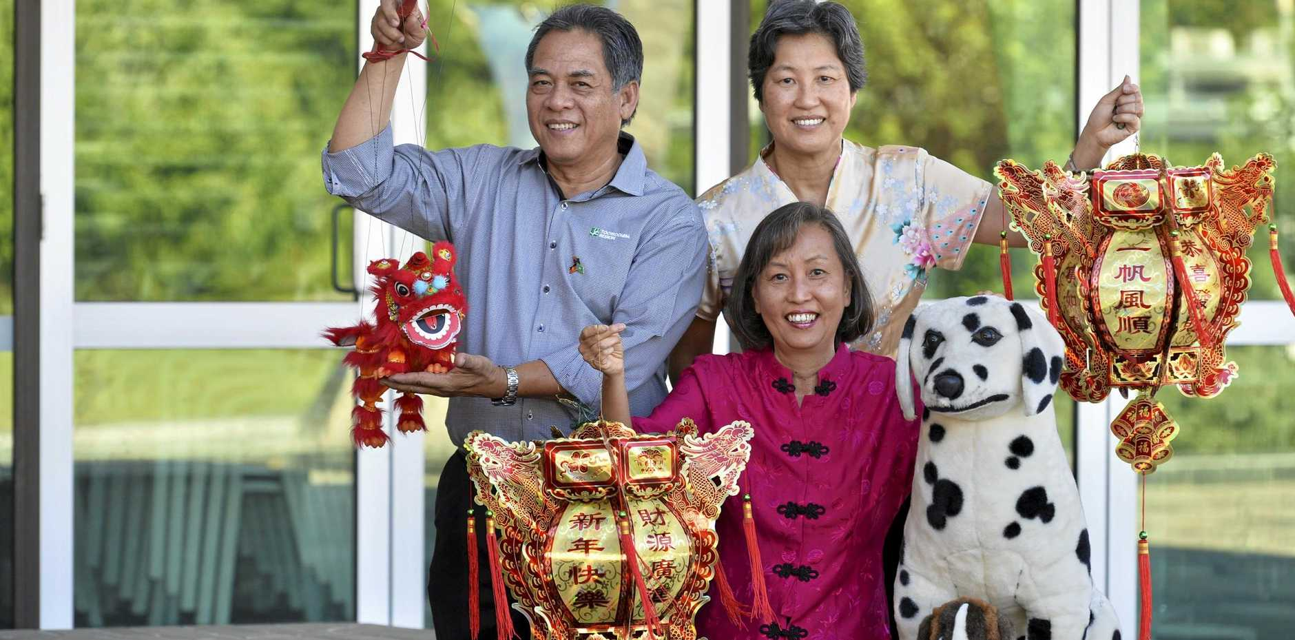 CELEBRATION TIME: Preparing for Chinese New Year celebrations are (from left) Roberto Garcia, Daphne Fung and Nancy Fung.