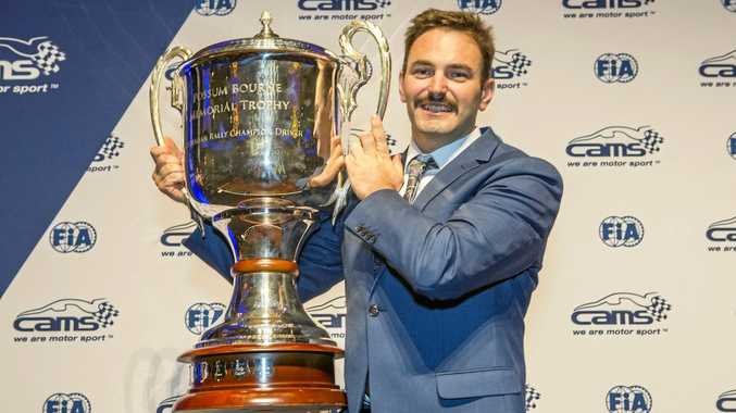 BIG PRIZE: Coffs Harbour rally driver Nathan Quinn with the Possum Bourne Memorial Trophy he won for being the Australian Rally Championship winner for 2017.