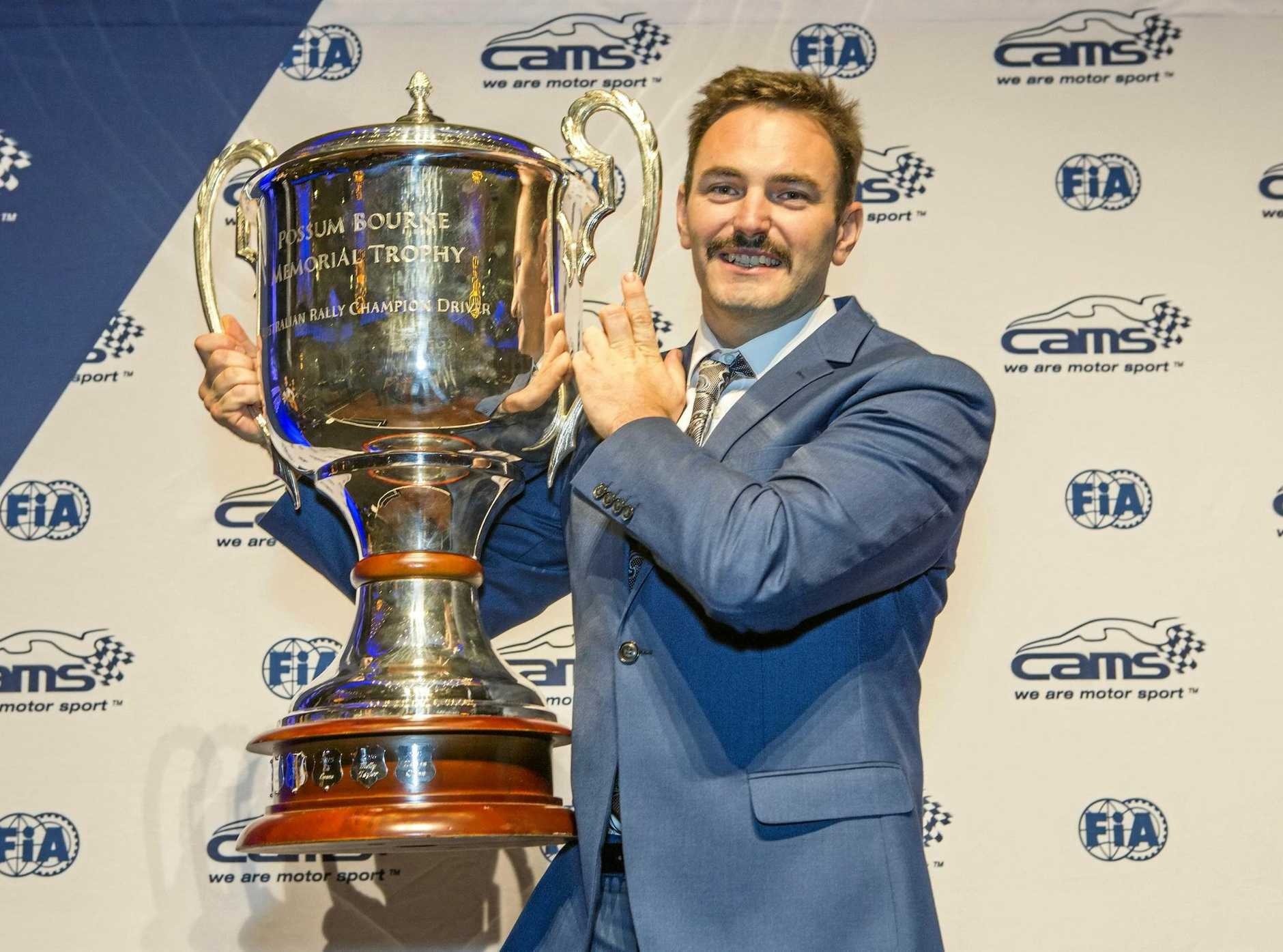 Coffs Harbour rally driver Nathan Quinn with the Possum Bourne memorial Trophy he won for being the Australian Rally Championships champion driver for 2017. Photo: Mark Teague Photography.