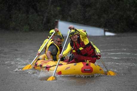Swift water rescue in Splitters Creek on Heales Road Sharon.