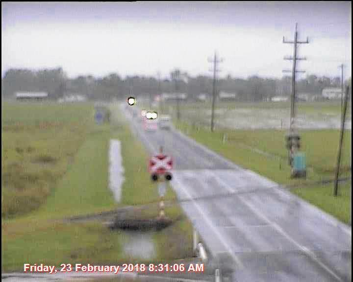 Hamilton Plains flood cam on Shute Harbour Rd looking toward Proserpine clearly shows water pooling by the side of the road.