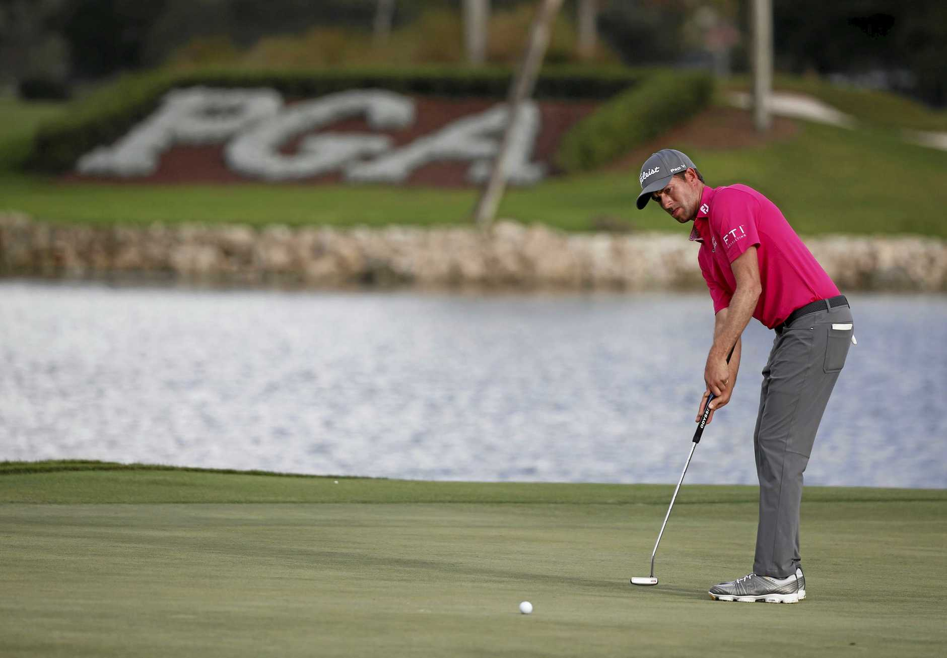 Webb Simpson putts out on the 18th hole during the first round of the Honda Classic.