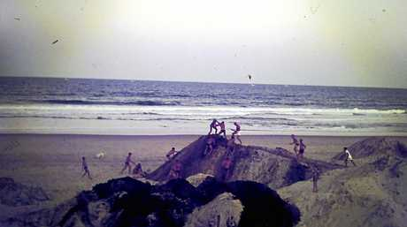 The 1966 photo of play fighting on giant piles of sand near the clubhouse.
