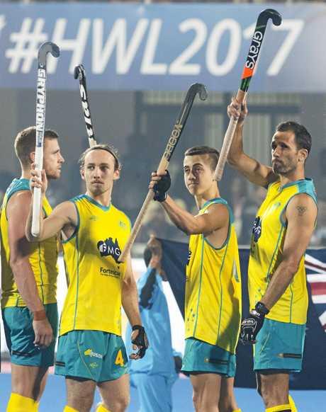 WAVING GOODBYE: Mark Knowles (far right) has proven a wonderful leader of the Australian hockey team.