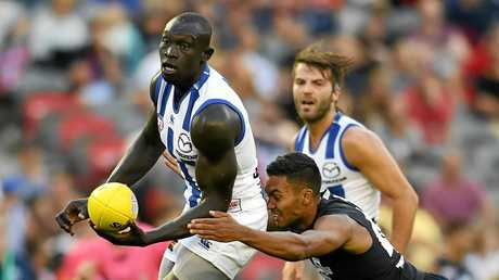 Majak Daw gets a handball away.