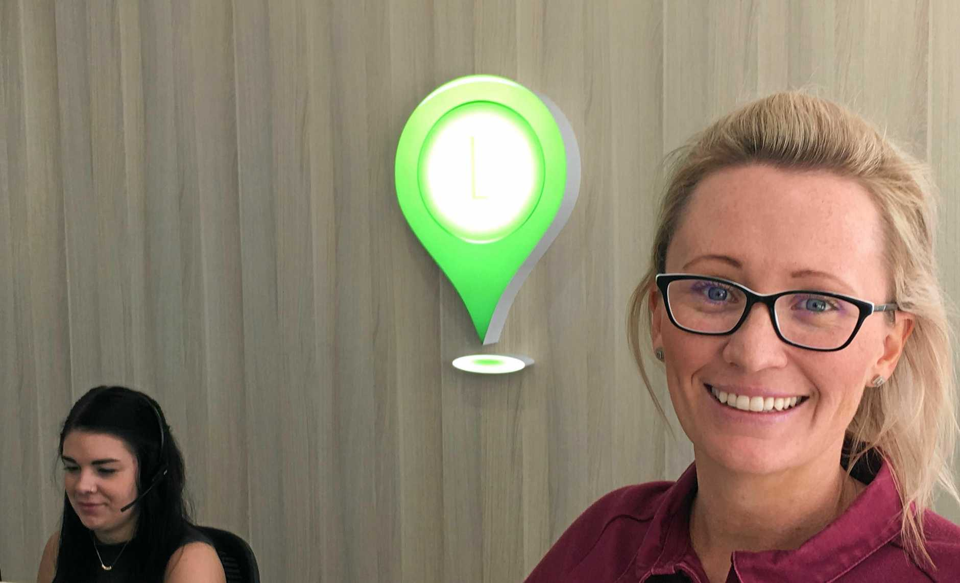 Locations Estate Agents director and property specialist Alicia Williams in their new premises at the GEA City Arcade building on Goondoon St Gladstone.