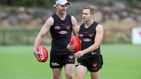 Jake Stringer (left) and fellow Bomber recruit Devon Smith.