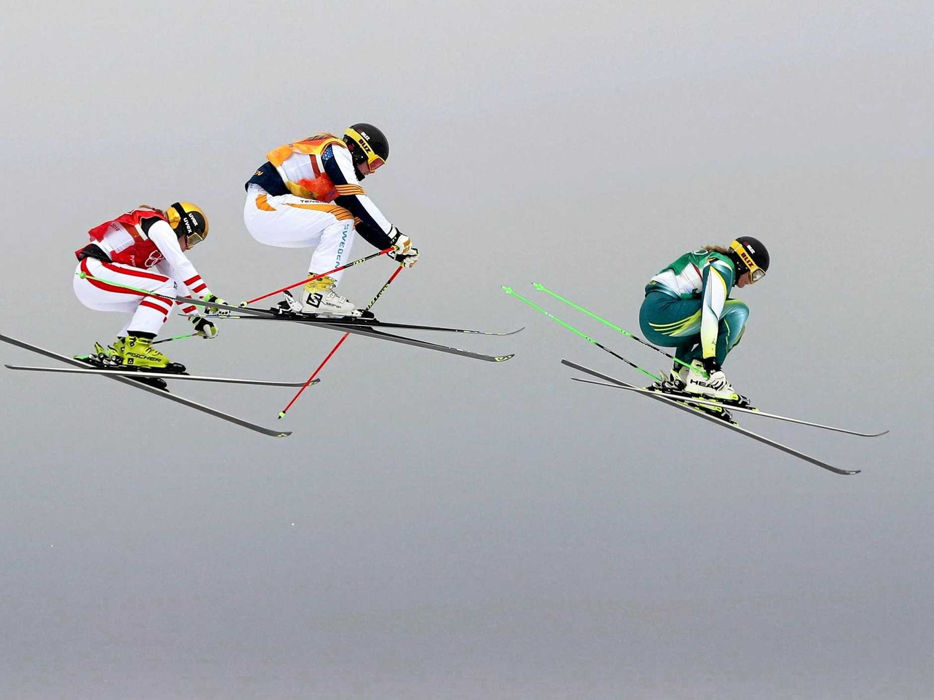 epa06556231 (from right) Sami Kennedy-Sim of Australia, Lisa Andersson of Sweden and Andrea Limbacher of Austria compete in the quarter finals of the Women's Freestyle Skiing Ski Cross competition at the Bokwang Phoenix Park during the PyeongChang 2018 Olympic Games, South Korea, 23 February 2018.  EPA/FAZRY ISMAIL