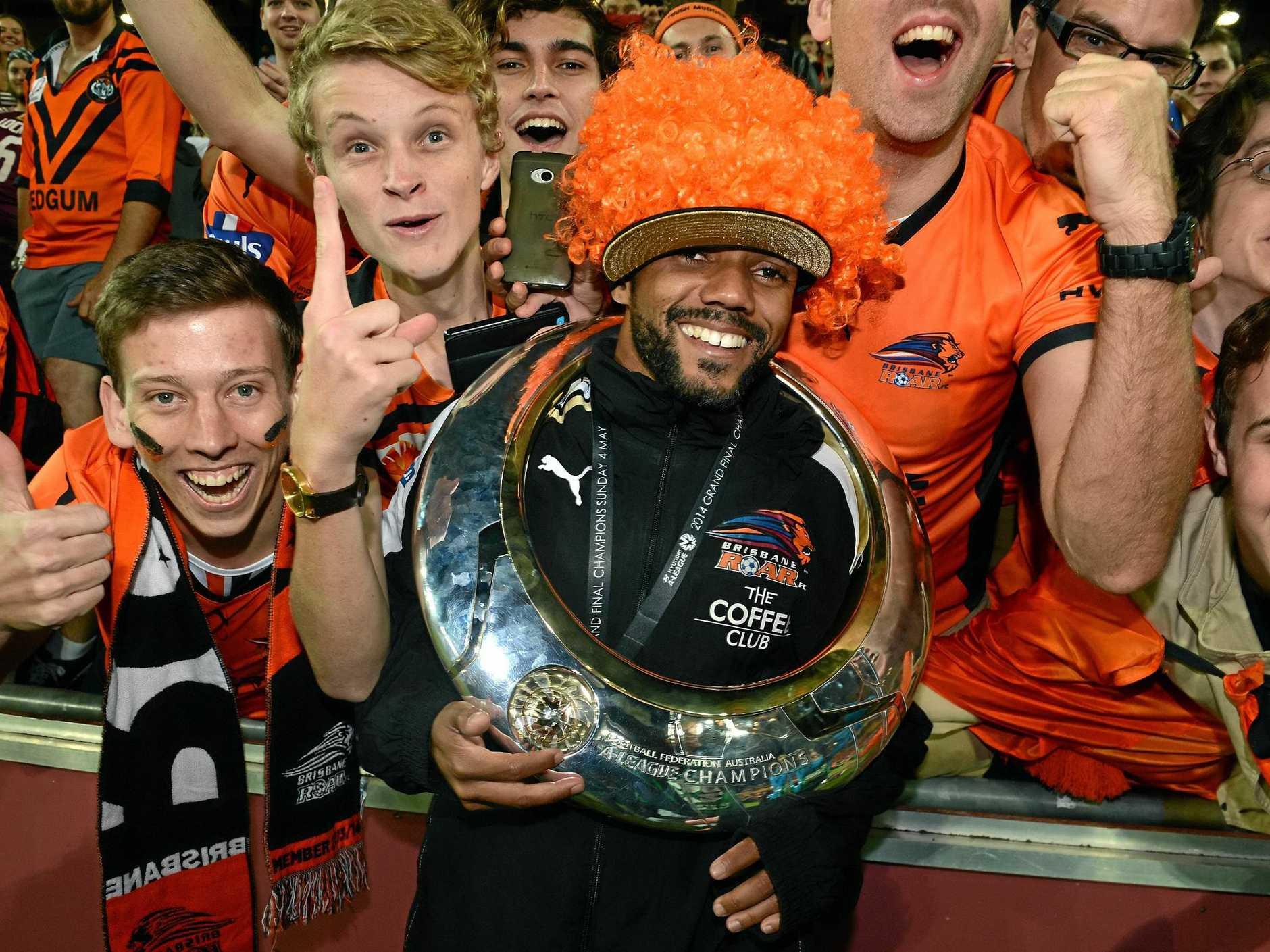 Henrique celebrates with Roar fans after teh 2014 grand final win.