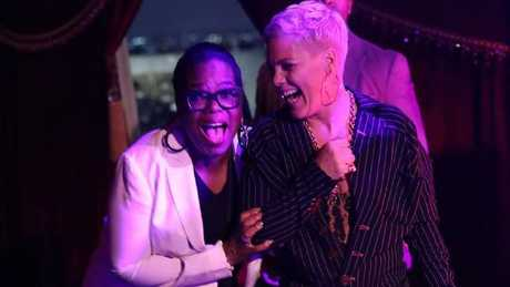Oprah and Pink have a giggle at Ellen's bash.