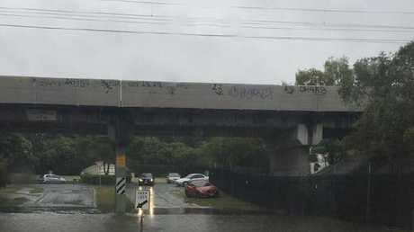 Flash flooding at Ancona St, Carrara, Gold Coast. Picture: Zach Leach