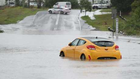 A car stranded in floodwaters at Marshall Rd, Rocklea. Picture: Peter Wallis