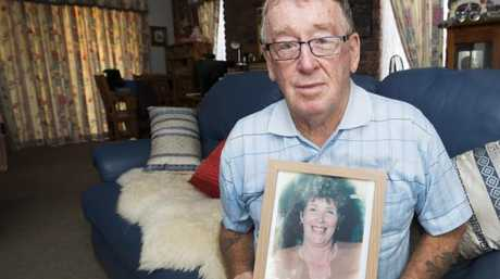 Ray Tucker with a framed photo of his wife. Picture: Lachie Millard