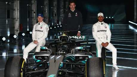 Bottas, Wolff and Hamilton pose for a photo with the Mercedes W09.