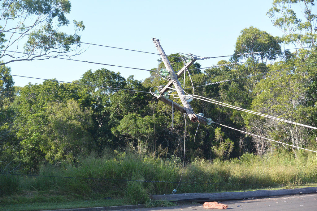 CRASH: The top of the powerpole dangling over Telegraph Rd after a crash.