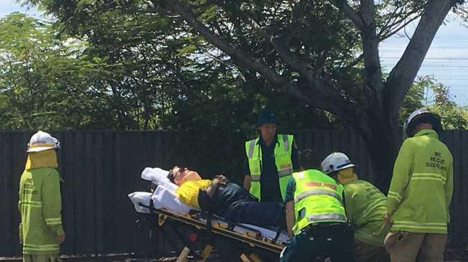 BREAKING: Toolooa St crash victim stretchered into ambulance