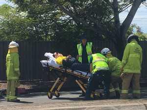 UPDATE: Toolooa St crash victim stretchered into ambulance