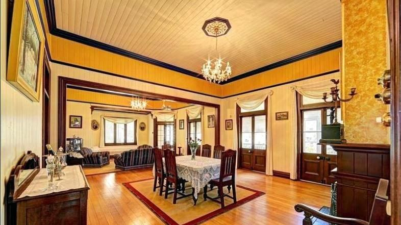 French doors, ornate ceilings, red cedar joinery and original hoop pine floors are some of the features.
